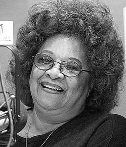 Mary Mason, who is the legendary on air personality at WHAT, an African American owned station, smiles while in the station's renovated studios. DN Photo/*Maialetti 05/29/2001